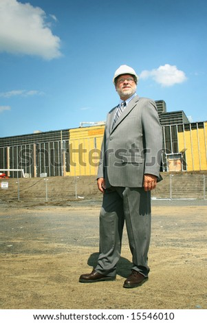 Architect in a building site - stock photo