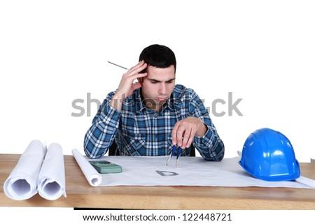 architect in office having a headache - stock photo