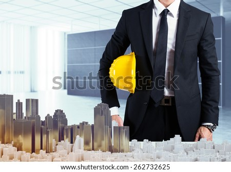 Architect in office shows the urban project - stock photo