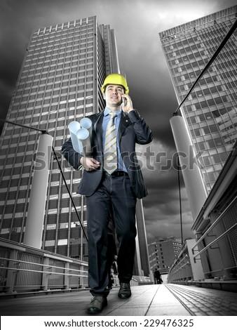 Architect in protective helmet - stock photo