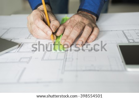 architect is working with blueprints, selective focus  - stock photo