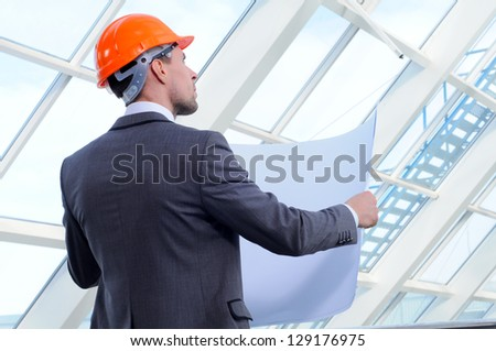 architect looking comparing housing project with building
