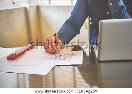 Architect man sketching a kitchen in his office