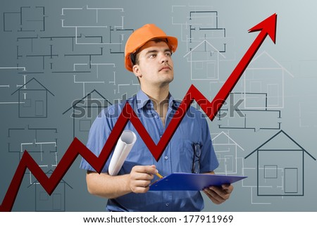 architect of the project examines the growing graph - stock photo