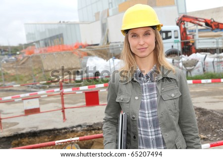 Architect on construction site with security helmet - stock photo