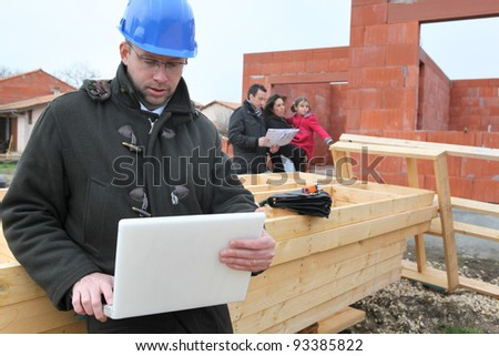 Architect on site with clients - stock photo