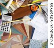 Architect or interior designer workplace desk and design tools with lots of construction material samples - stock photo