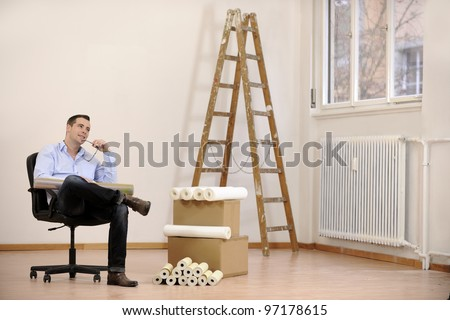 Architect or owner in empty office room - stock photo