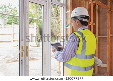 Architect planning the garden with a tablet pc - stock photo
