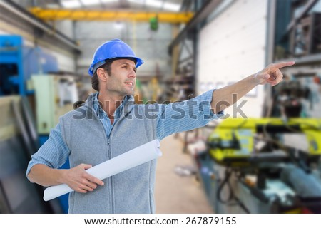 Architect pointing against workshop