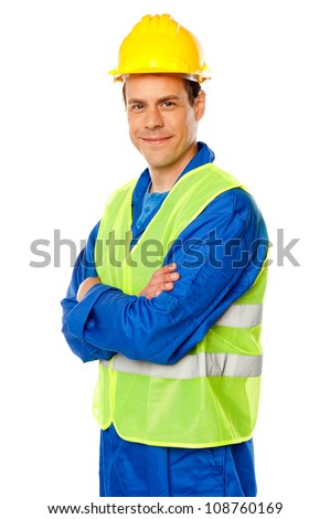 Architect posing with crossed arms in style against white background - stock photo