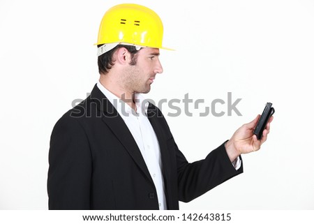 architect puzzled at sms - stock photo