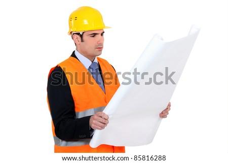 Architect reading plans - stock photo