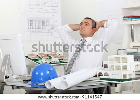architect relaxing in his office - stock photo