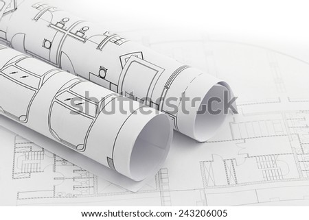 Architect rolls and plans, construction plan drawing - stock photo