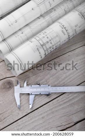 Architect rolls project drawing blueprint - stock photo