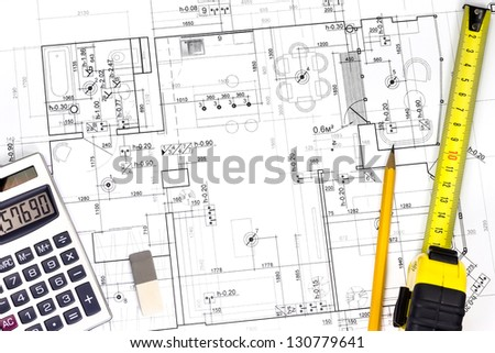 Architect's workspace with plans and tools - stock photo