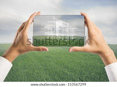 Architect showing new house project with tablet - stock photo