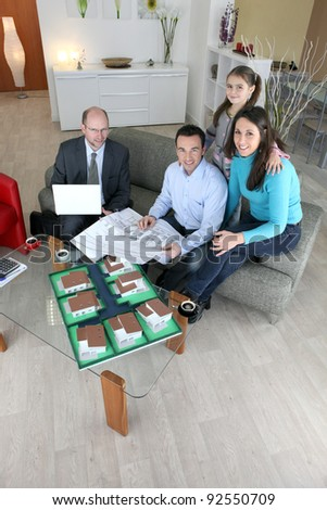 Architect sitting with a family - stock photo