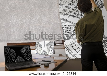 Architect standing in office holding building plan, with laptop on the table showing digital structure of building. - stock photo