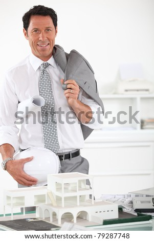Architect stood by model houses - stock photo