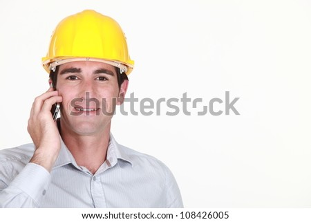 Architect stood making a call