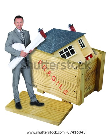Architect stood with model house in background