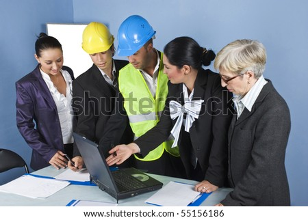 Architect team in office having a meeting in a office ,a young engineer woman using  laptop and they discuss together - stock photo