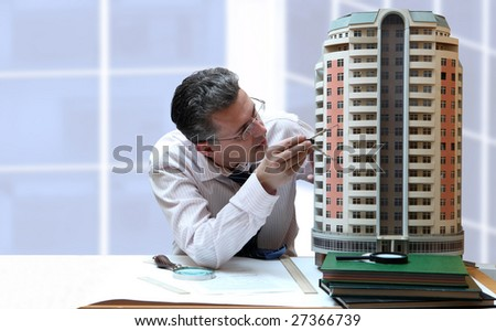 Architect with a breadboard model of a building - stock photo