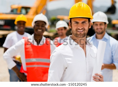 Architect with a group of construction workers holding blueprints  - stock photo