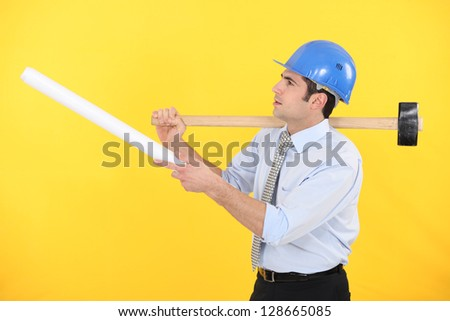 Architect with  a mallet - stock photo
