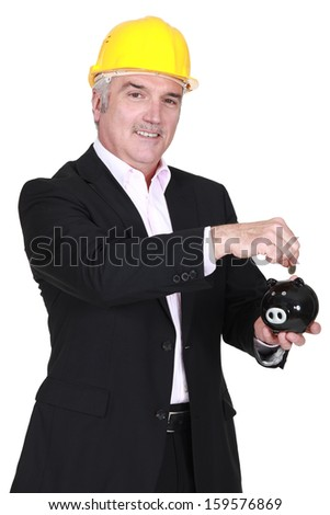 Architect with a piggy bank. - stock photo