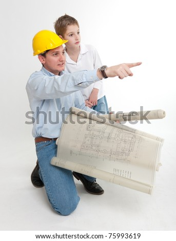 Architect with blueprints explaining something to a little boy - stock photo