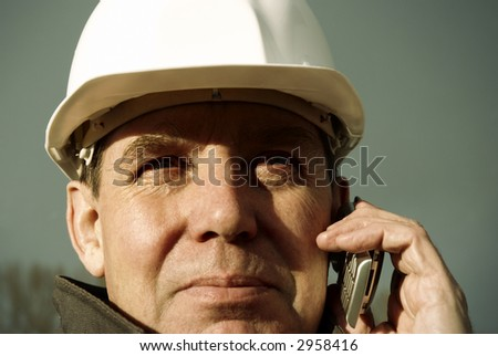 architect with cell-phone - stock photo