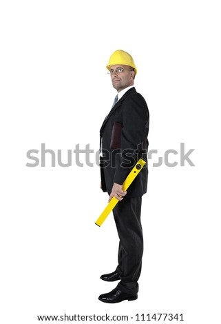 Architect with helmet and bubble level - stock photo