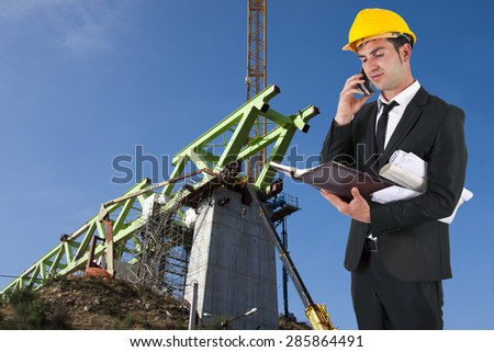 architect with plans and helmet work