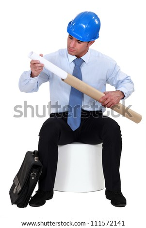 Architect with plans in a cardboard tube - stock photo