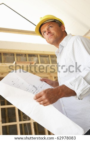 Architect With Plans In New Home - stock photo