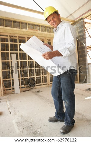 Architect With Plans In New Home