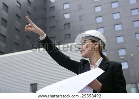 architect woman working outdoor with modern buildings - stock photo