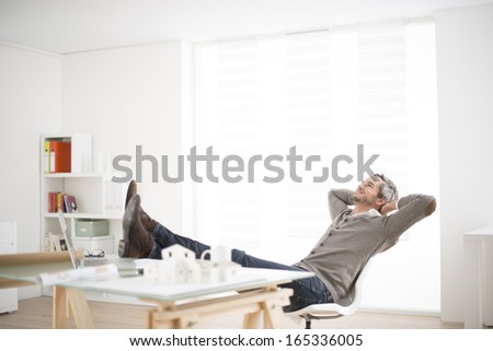 architect working at his laptop on the office - stock photo