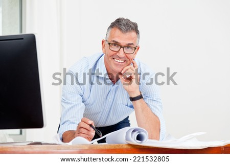 architect working in office - stock photo