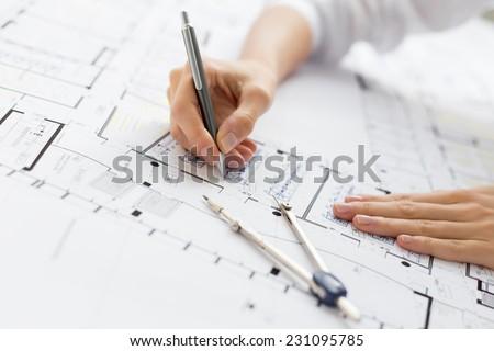Architect working on blueprint - stock photo