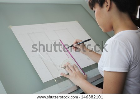 Architect working on her plan - stock photo