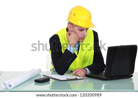 architect working on laptop - stock photo
