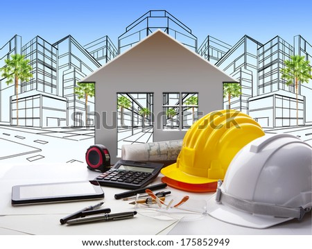 architect working table with construction industry and engineer working tool on top of table use for real estate and property land development theme  - stock photo