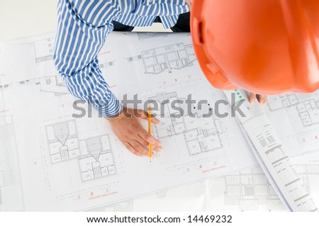 Architect working with technical drawings - stock photo