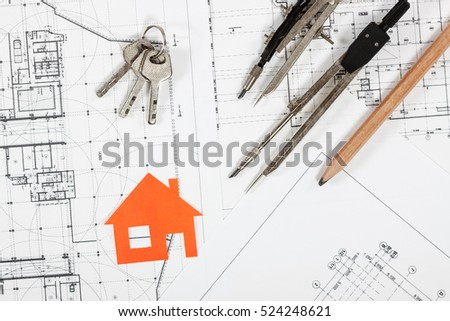Architect workplace top view. Architectural project, blueprints, calculator, red alarm clock, keys, divider compass and pencil on desk table. Real Estate Concept.