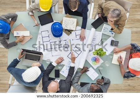 Architects and Engineers Planning on a New Project - stock photo