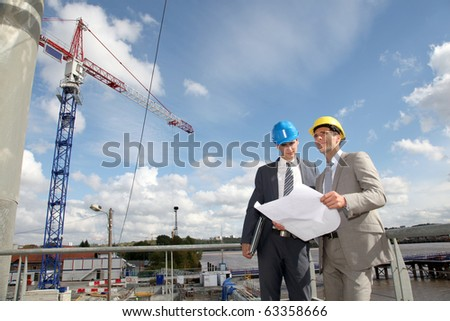 Architects checking site under construction - stock photo
